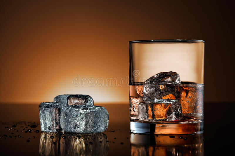 Whiskey glass with warm background stock photo