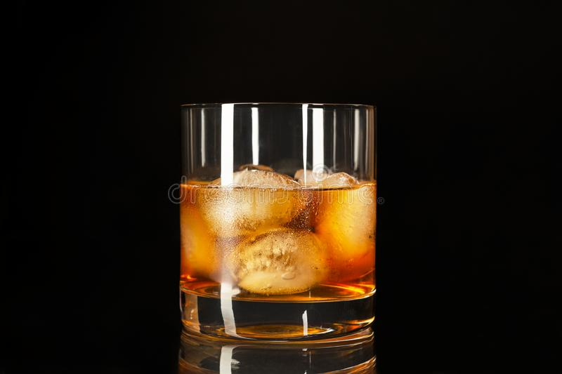 Whiskey highball on the black background, copy space. Classic whiskey highball on the black background, copy space Whiskey stock image