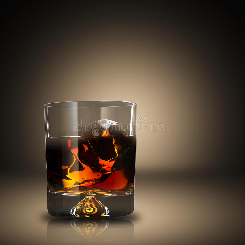 Whiskey With Ice Cubes. Close up of whiskey with ice cubes stock photo