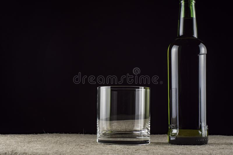 Whiskey is poured into a glass royalty free stock photos
