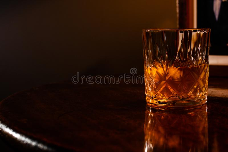 Whiskey on the rocks in a crystal tumbler royalty free stock photos