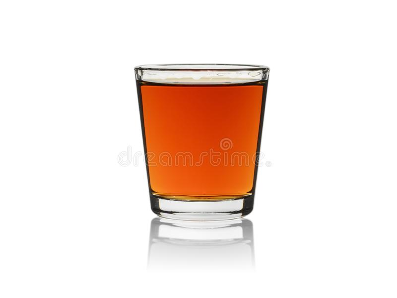 Whiskey in shot glass, isolated on a white background royalty free stock photography