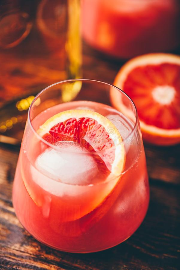 Whiskey sour cocktail with blood orange juice stock image