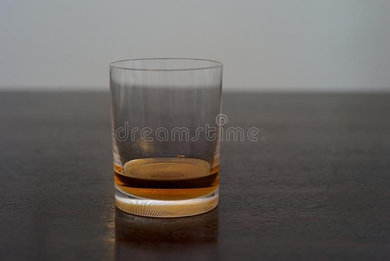 Whiskey in a Tumbler on a Wooden Table stock photo