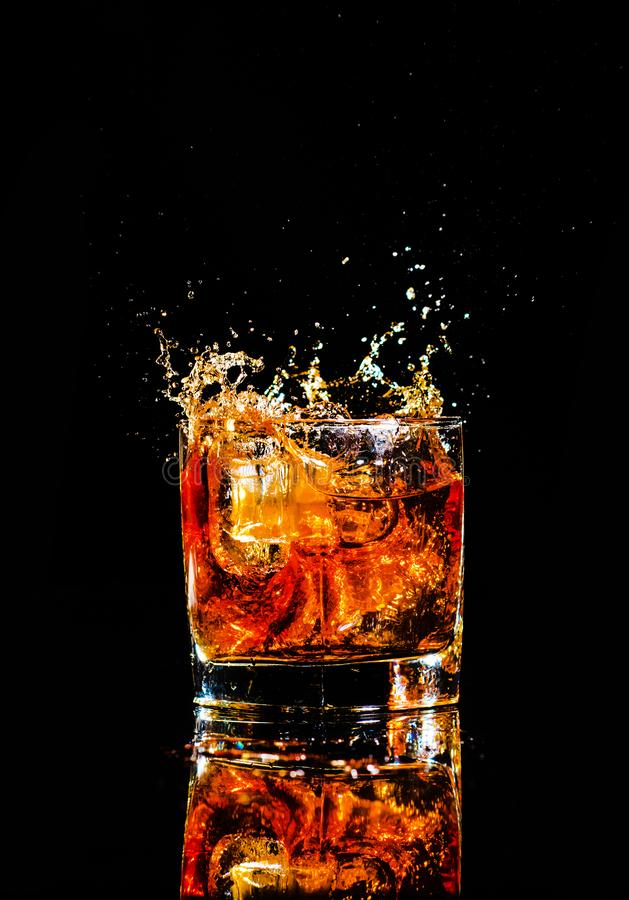 Free Whiskey With Splash On Black Background, Brandy In A Glass Stock Photos - 148356723
