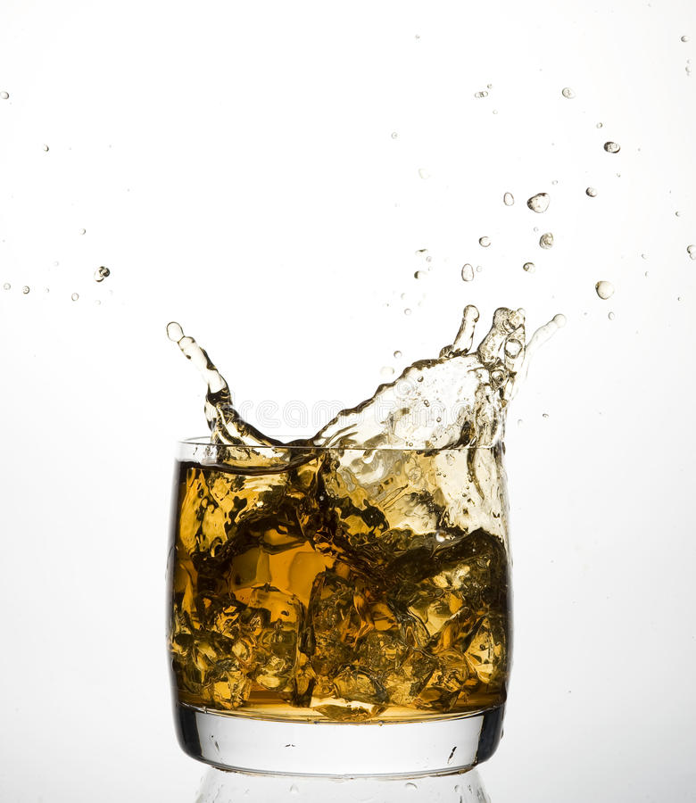 Whisky. And ice. Brown scotch stock photo