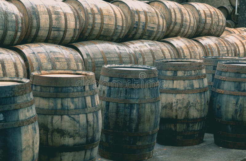 Whisky barrels full of whiskey in Scottish traditional distiller stock images