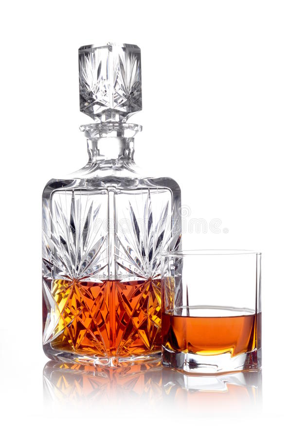 Whisky in a carafe and a glass isolated on white. Studio shot of whisky in a carafe and a glass isolated on white stock photography