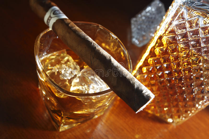 Whisky and cigar. On wooden counter royalty free stock images