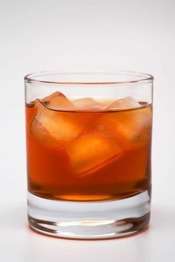 Whisky con un ghiaccio fotografia stock