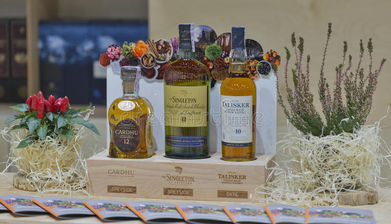 Whisky Dram Festival in Kiev, Ukraine. Speyside and Skye Single Malt Scotch Whisky bottles on display closeup in a row on booth at 1st Ukrainian Whisky Dram stock photo