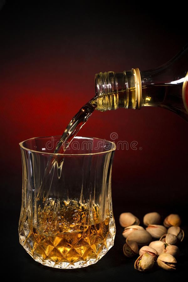 Free Whisky Filling A Glass Stock Photo - 18432160
