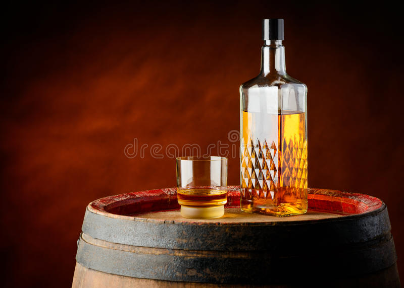 Whisky glass and bottle stock image