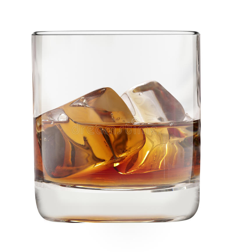 Whisky glass filled with whisky and ice. Isolated on white stock photo