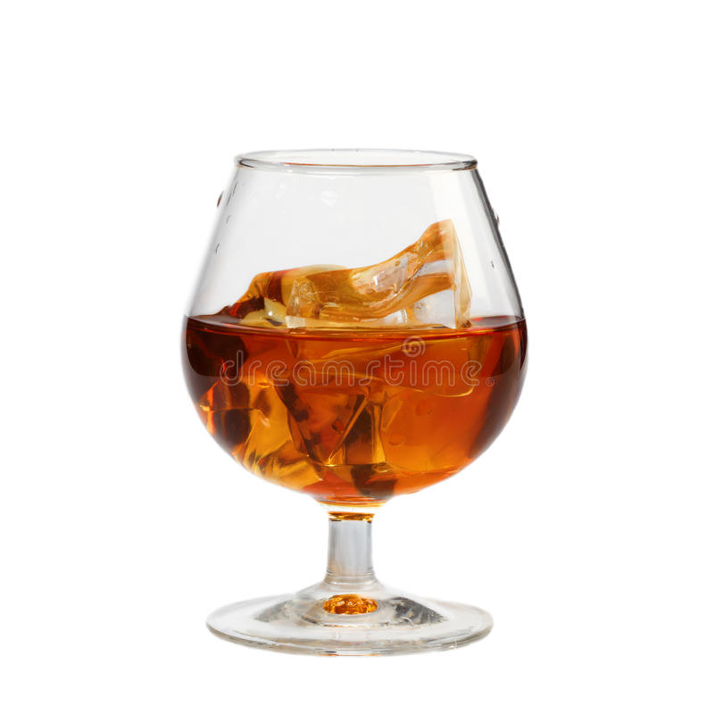 Whisky glass with ice. Isolated royalty free stock photography