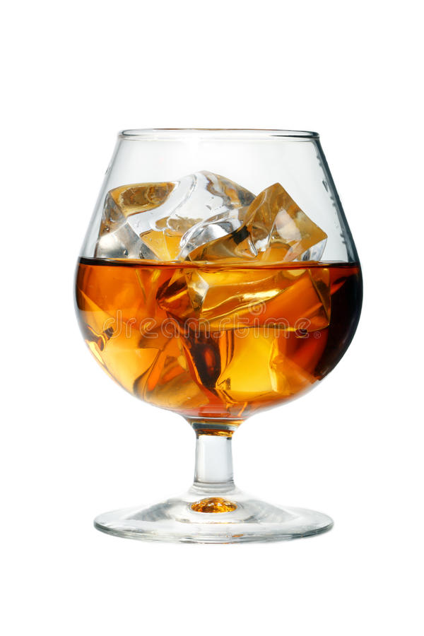 Whisky glass with ice. A white background royalty free stock images