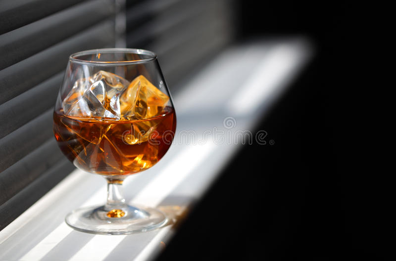 Whisky glass with ice royalty free stock photography