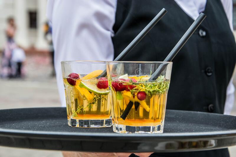 2 Whisky Glasses Filled With Beverage on Black Tray stock images