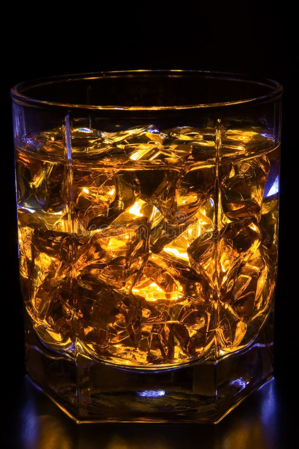 Whisky with ice. Glass of whisky with ice royalty free stock photo
