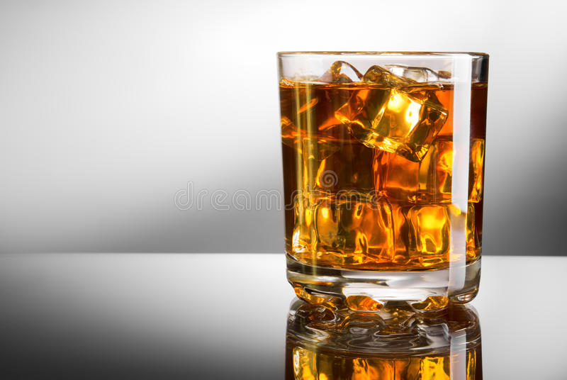 Whisky and ice. Whisky glass with ice cubes royalty free stock photo