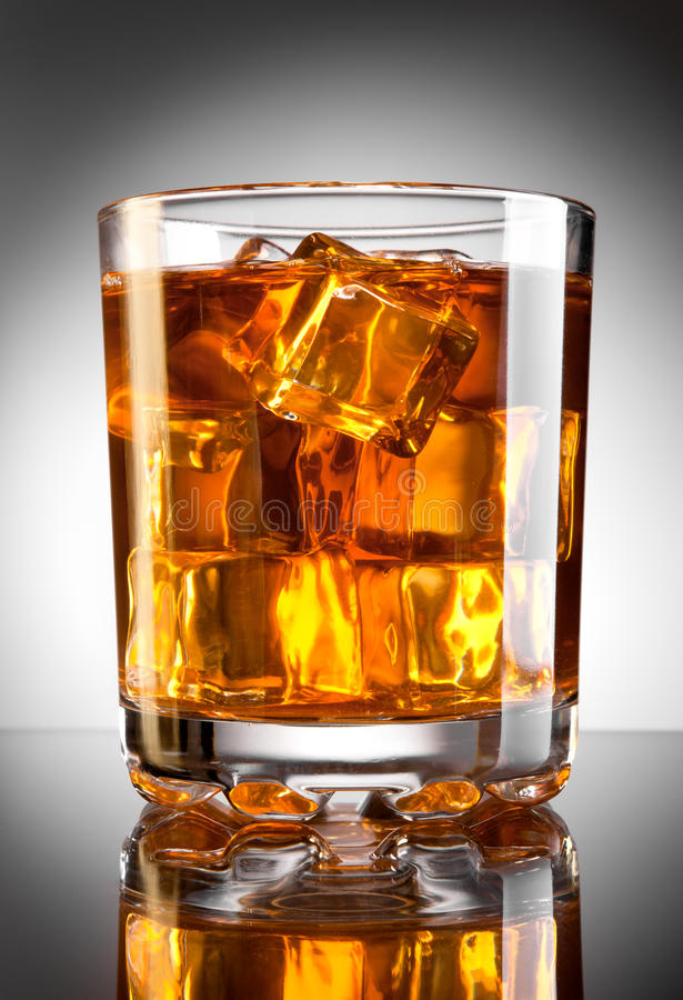 Whisky and ice. Whisky glass with ice cubes stock image