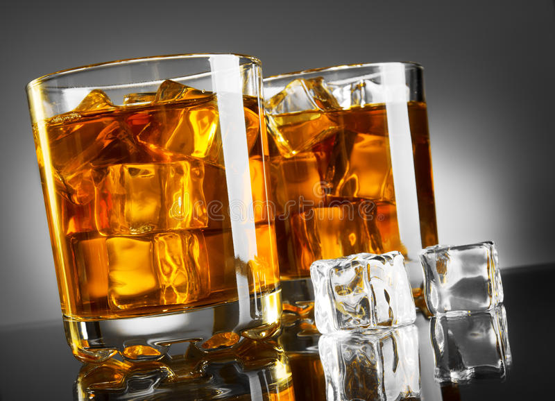 Whisky and ice. Whisky glass with ice cubes stock images