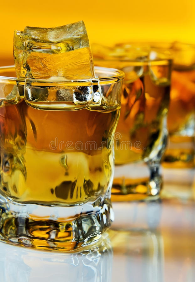 Whisky with ice. Whisky with ice , focus on a foreground royalty free stock photo