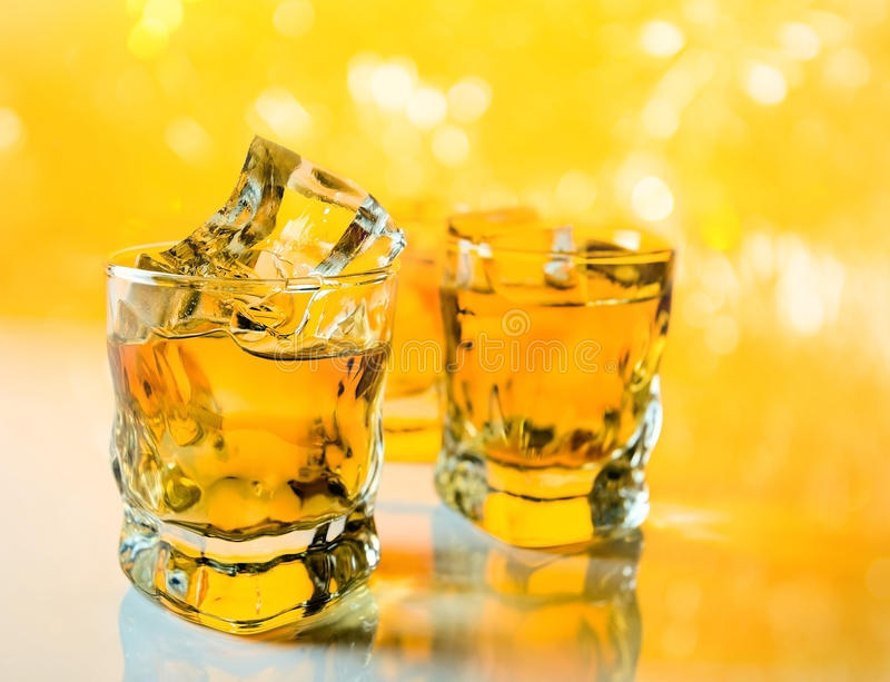 Whisky with ice . Whisky with ice , focus on a foreground royalty free stock image