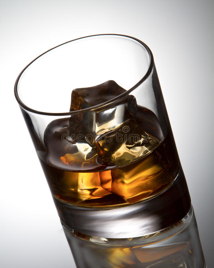Whisky and ice cube. A studio shot royalty free stock photos