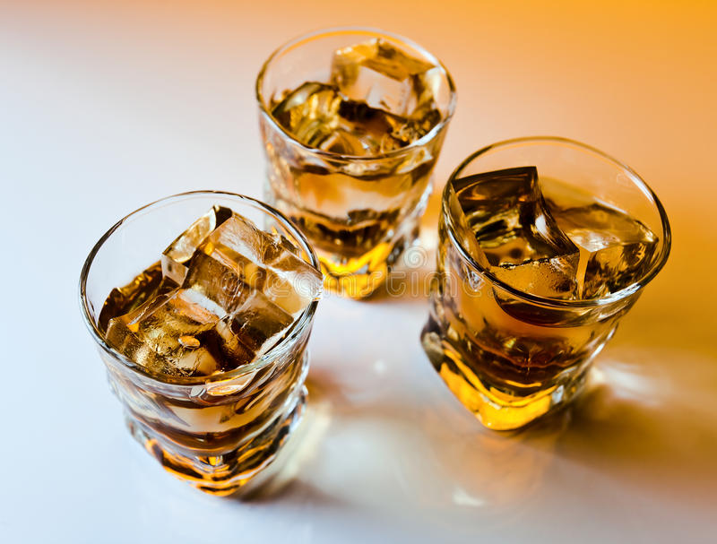 Whisky with ice. Focus on a foreground royalty free stock images