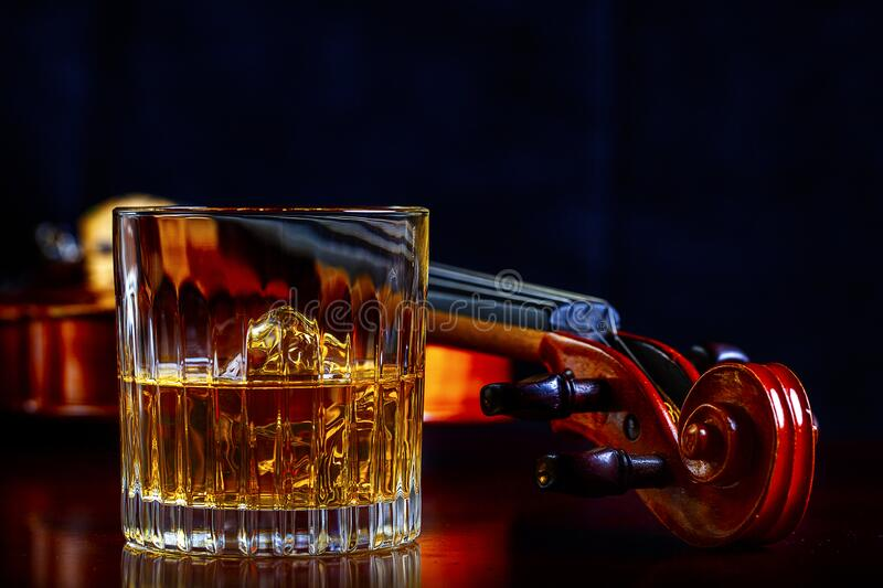 Whisky with Ice and Violin stock image