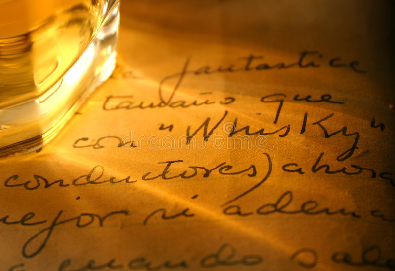 Whisky and old diary stock photography