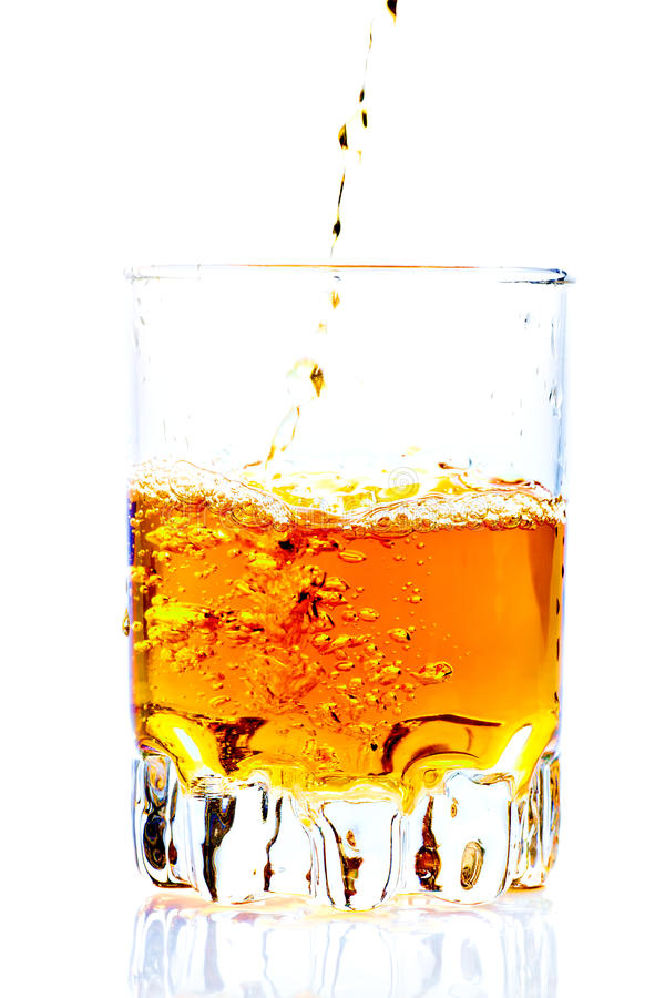 Free Whisky,rum Or Any Other Golden Liquor Being Poured Royalty Free Stock Photos - 16361218