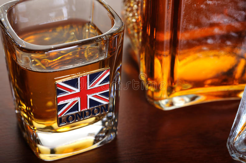 Whisky shot and decanter royalty free stock photography
