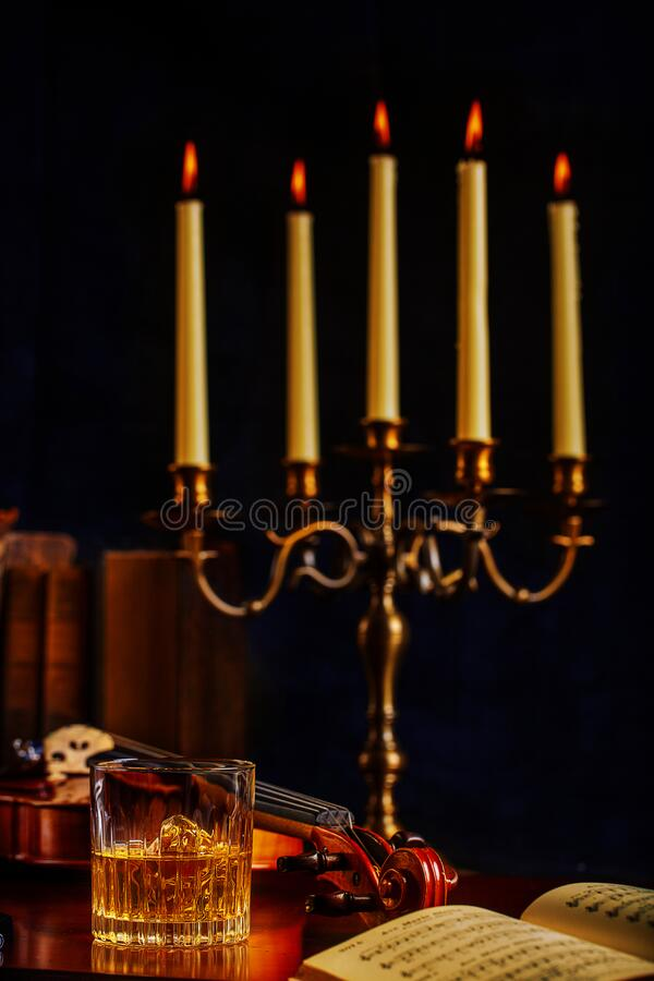 Whisky Violin Music and Candelabra royalty free stock photo