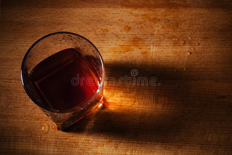 Whisky on a wooden table stock photos