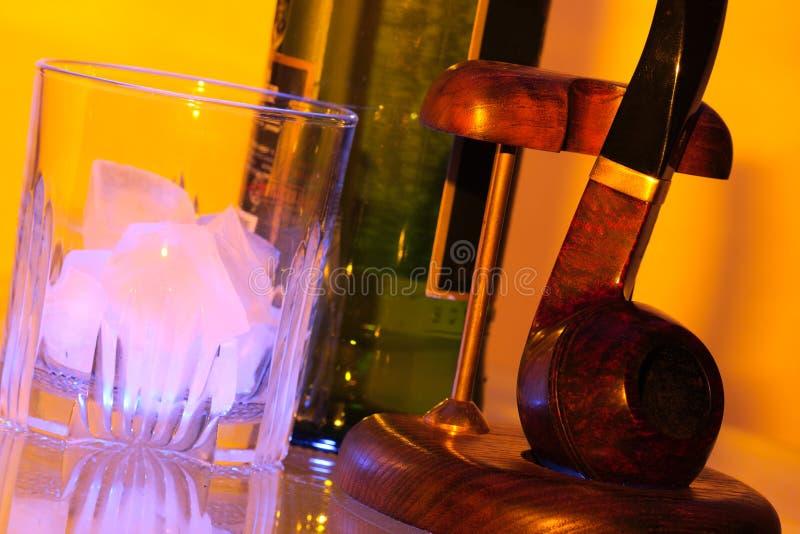 Whisky y tubo del hielo imagen de archivo