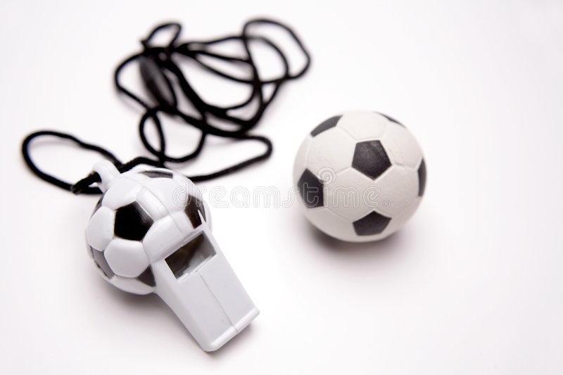 Whistle and ball royalty free stock photo