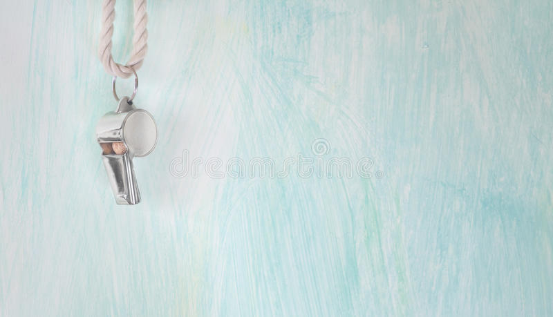 Whistle of a soccer / football referee / coach. Free copy space stock photo