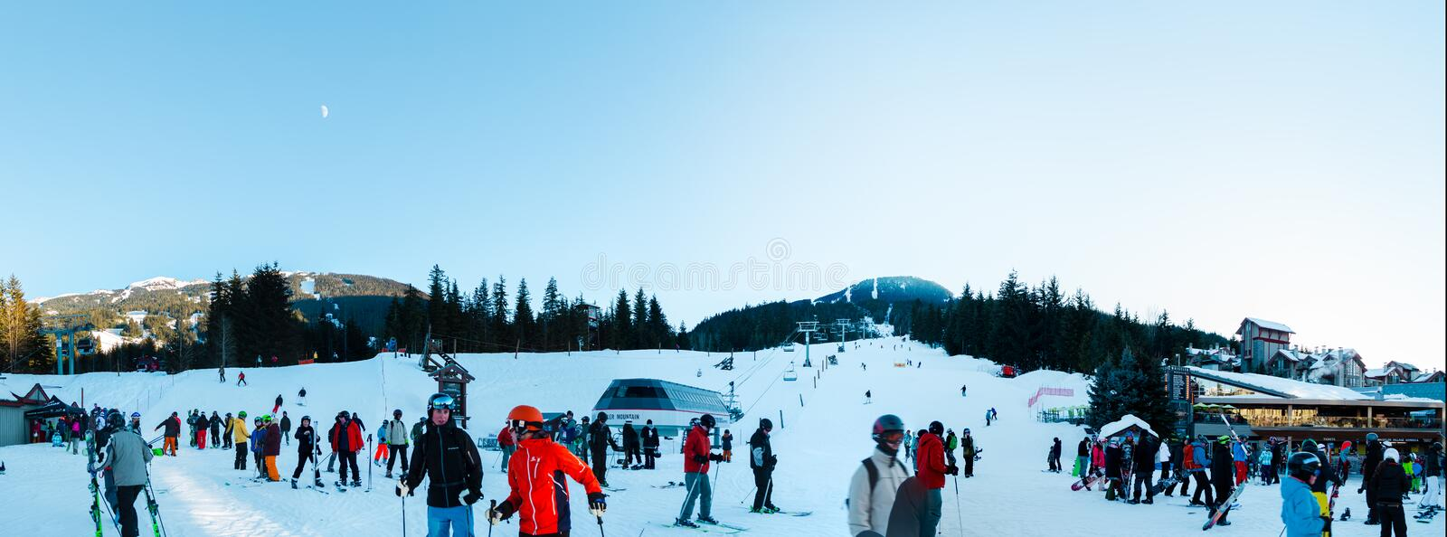 WHISTLER, BC, CANADA - JAN 14, 2019: A view of skiers coming down the hill as seen from Whistler village. stock images