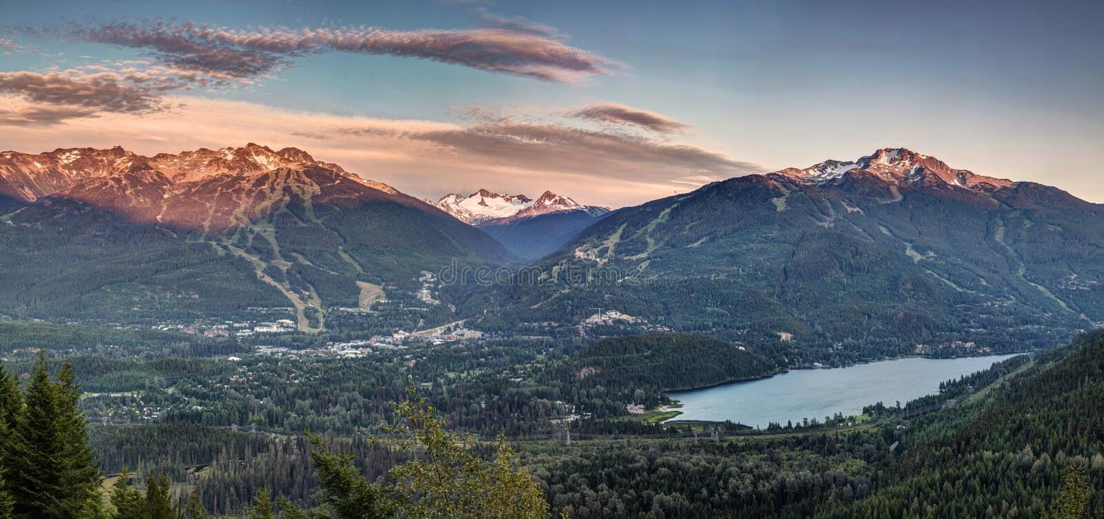 Whistler Blackcomb sunset Panorama. 12 exposures to create this panoramic photo of Whistler Blackcomb at sunset. I was waiting for the traffic to subside before royalty free stock images