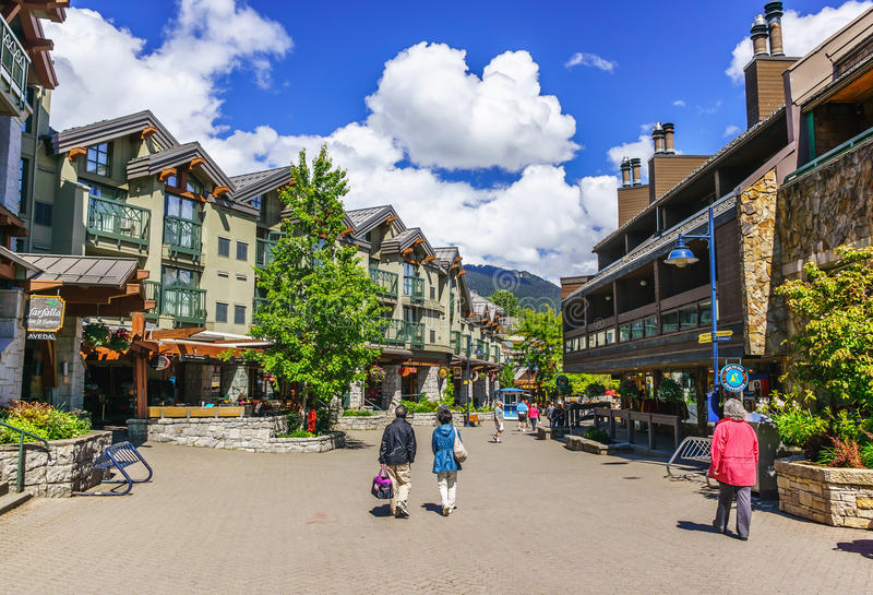 Whistler. BRITISH COLUMBIA, CANADA – JUNE 10, 2013: Tourists ramble on the street of , co-host of the 2010 Olympic Games. It is a Canadian resort town stock photography