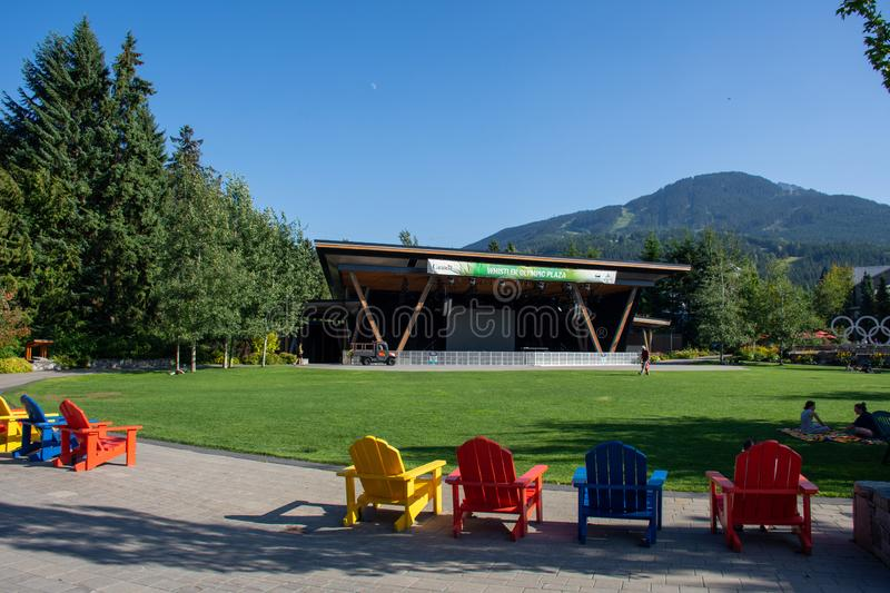 Whistler Olympics Village from 2010 Winter Games. Open Square in summer looking at mountain range and stage royalty free stock image