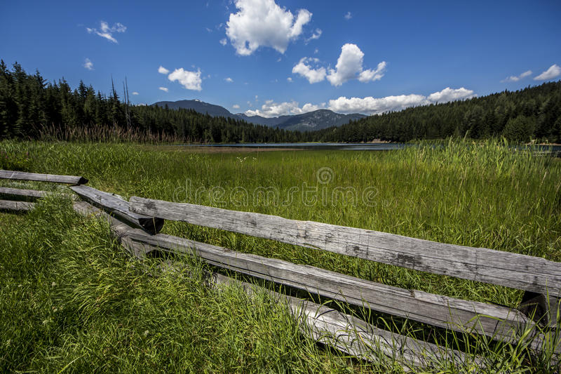 Nature of Whistler. A good view of Lost Lake in Whistler, BC, Canada at summer mixed with an amazing Wood Fence stock photos