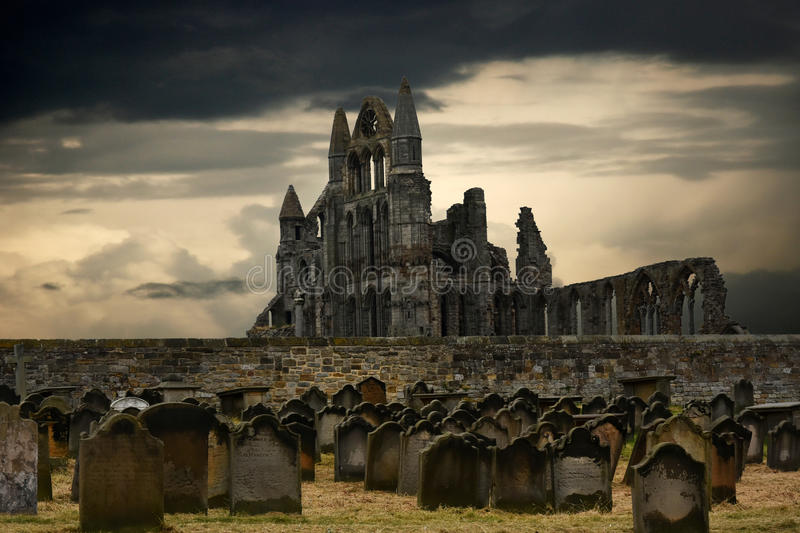 Whitby abbey and cemetery. Whitby abbey, north yorkshire, UK, with gravestones in the foreground stock photo