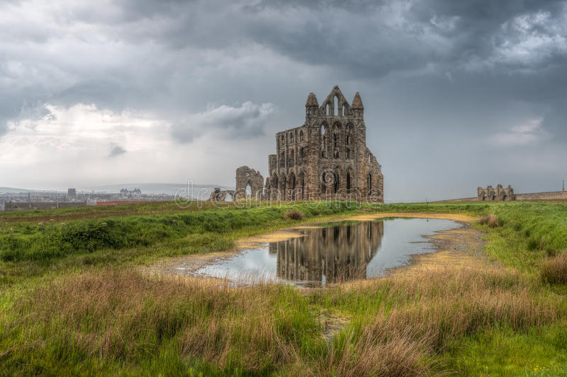 Whitby Abbey, England. Whitby Abbey is a ruined Benedictine abbey overlooking the North Sea on the East Cliff above Whitby in North Yorkshire, England. It was stock photo