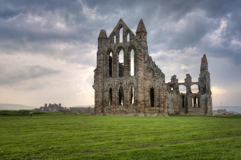Whitby Abbey, England. Whitby Abbey is a ruined Benedictine abbey overlooking the North Sea on the East Cliff above Whitby in North Yorkshire, England. It was stock photography