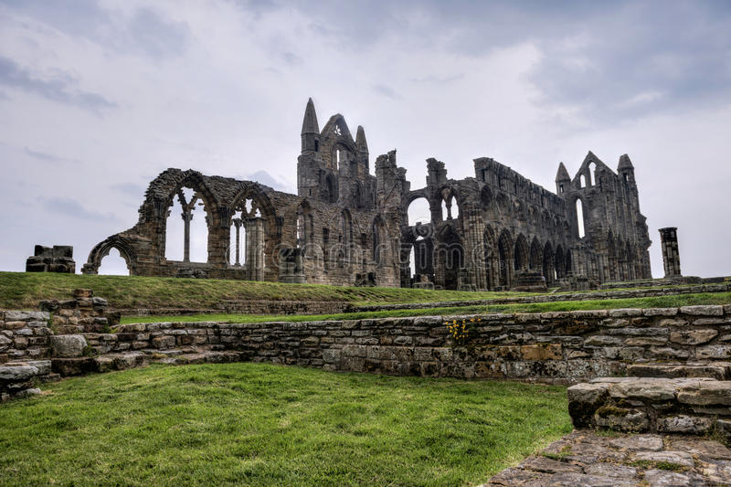 Whitby Abbey, England. Whitby Abbey is a ruined Benedictine abbey overlooking the North Sea on the East Cliff above Whitby in North Yorkshire, England. It was royalty free stock photos