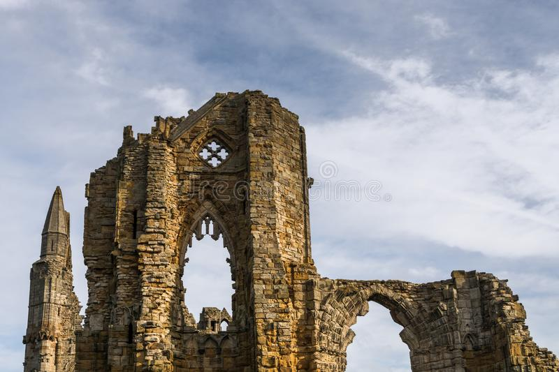 Whitby Abbey. Set against a cloudy blue sky stock images