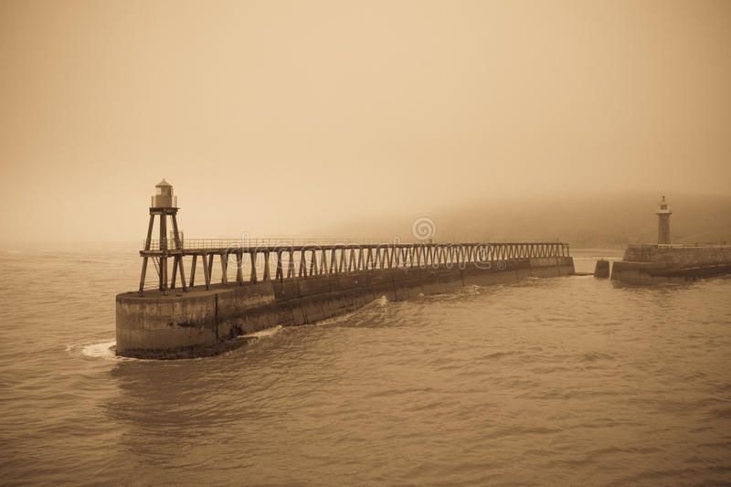 Whitby East Pier in fog stock photography